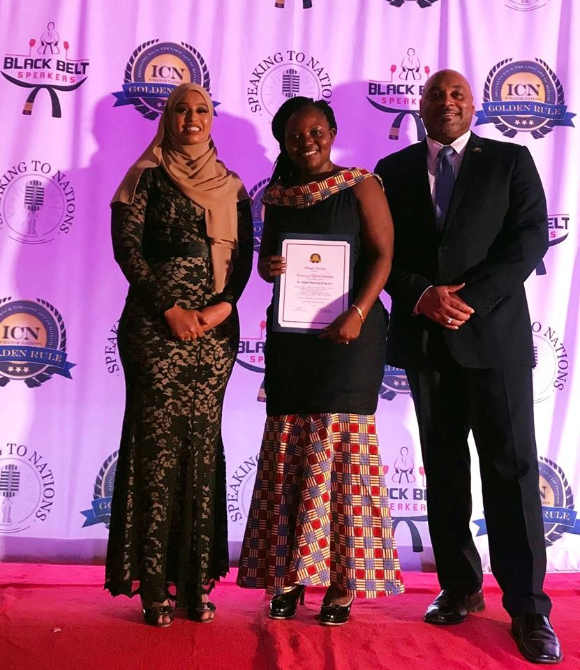 Dr. Sellah King'oro receiving her Women of Global Solutions Inaugural Honor Award by the prestigious iChange Nations and Women of Golden Rule Dialogue awards for her brilliant mind that brings solutions to the issues around her.