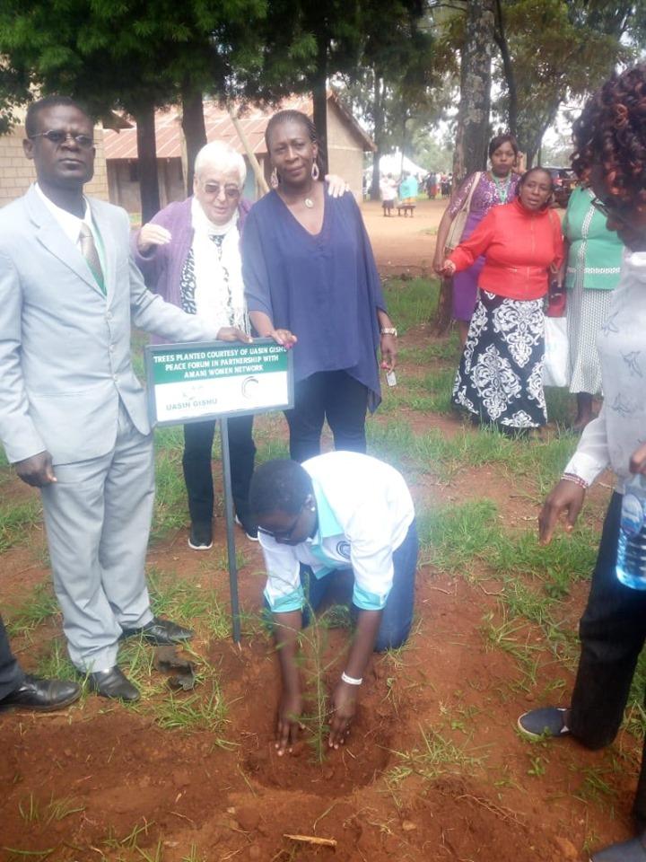 Jeddah Otieno planting trees at Uasin Gishu  tree planting day.